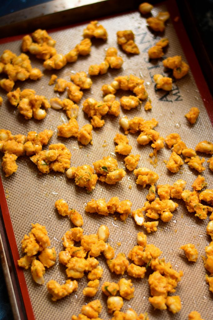 Baked Masala Peanuts coated in a crunchy, savory batter of gluten-free flour and spices makes for a wonderful tea time snack!