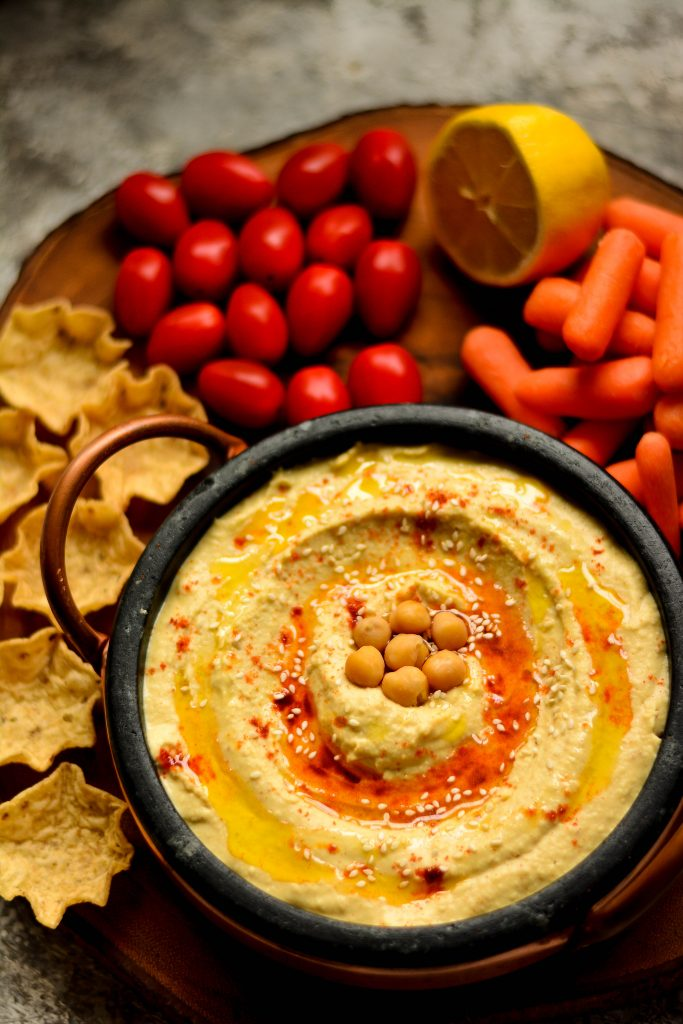 You haven't had good hummus, if you did not have it served warm. Try this recipe - it would be the best homemade Hummus you've ever had!